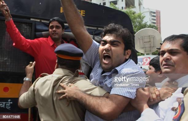 Members of Bharatiya Janata Yuva Morcha protest against film maker Ram Gopal Varma outside Verrsova police station for his statement on casting Maria...