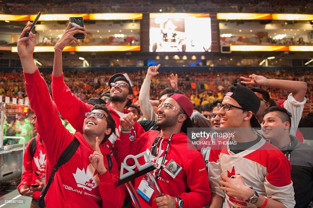 Members of Blizzard Team 188 of Toronto, Canada celebrate during the FIRST Robotics Championships on April 30, 2016 in St. Louis, Missouri. Six hundred teams representing 10 countries compete over three days. / AFP / Michael B. Thomas