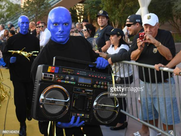 Members of Blue Man Group arrive at the Vegas Golden Knights' inaugural regularseason home opener against the Arizona Coyotes at TMobile Arena on...