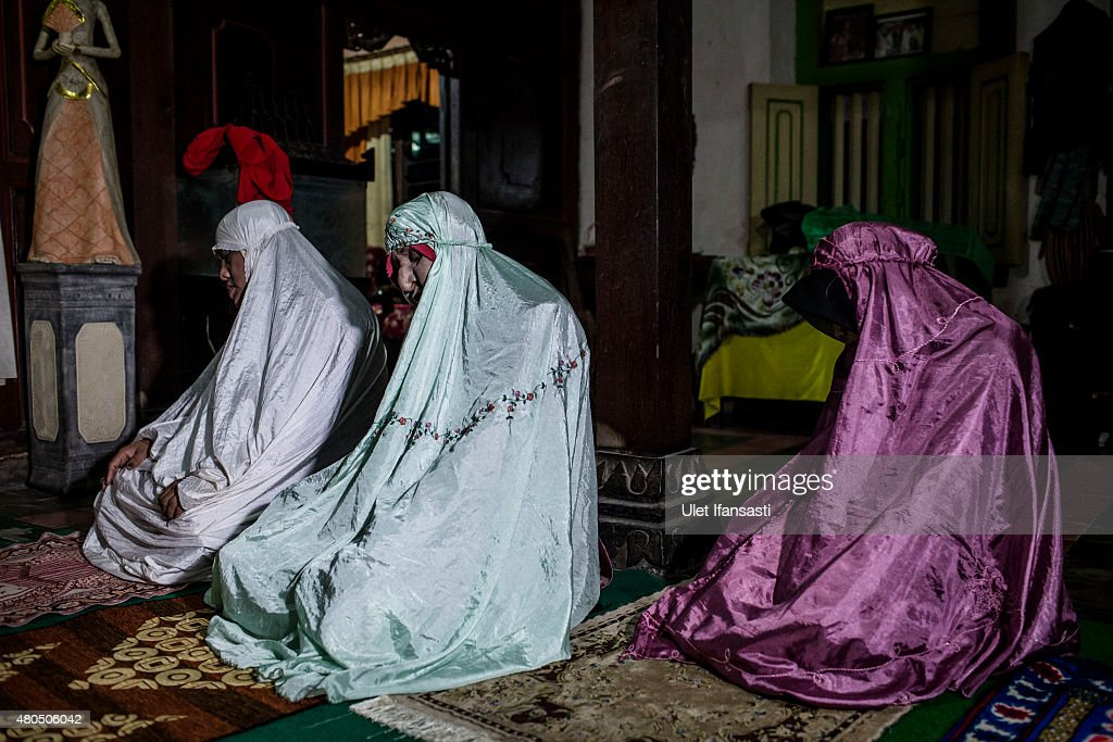 Members of boarding school for transgenders known as pesatren 'waria', called Al-Fatah, pray during Ramadan on July 12, 2015 in Yogyakarta, Indonesia. During the holy month of Ramadan the 'waria' community gather to break the fast and pray together. 'Waria' is a term derived from the words 'wanita' (woman) and 'pria' (man). The Koran school Al-Fatah was set back last year's by Shinta Ratri at her house as a place for waria to pray, after their first founder Maryani died. The school operates every Sunday. Islam strictly segregates men from women when praying, leaving no-where for 'the third sex' waria to pray before now.