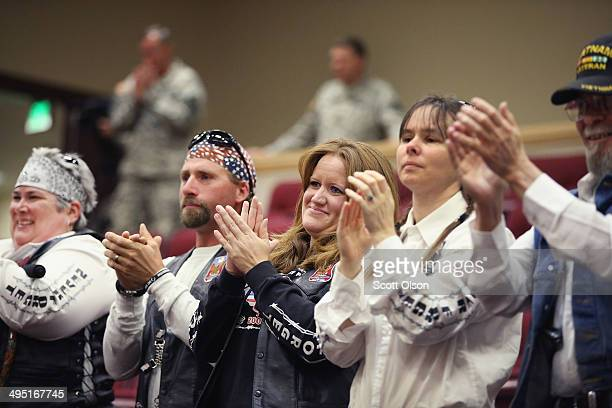 Members of Boise Valley POW MIA stand and applaud as Bob and Jani Bergdahl arrive at a press conference to discuss the release of their son Sgt Bowe...