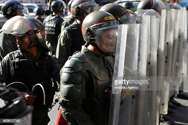 Members of Bolivarian National Guard stand guard as demonstrators stage a protest to demand the release of Venezuelan opposition leader Leopoldo...
