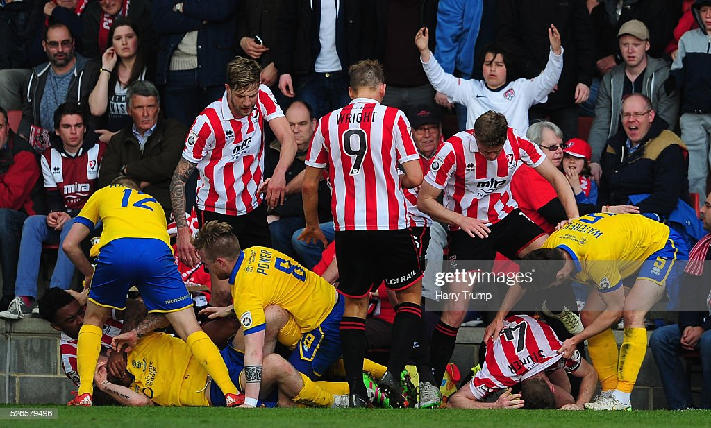 Members of both sides clash during the Vanarama Football Conference match between Cheltenham Town and Lincoln City at the World of Smile Stadium on April 30, 2016 in Cheltenham, England.