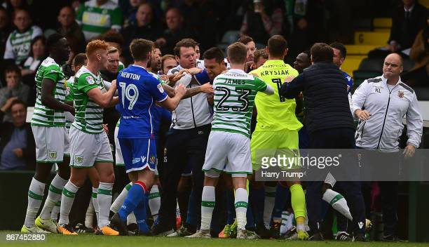 Members of both sides clash resulting in red cards for Olufela Olomola of Yeovil Town and Kevin Toner of Stevenage during the Sky Bet League Two...