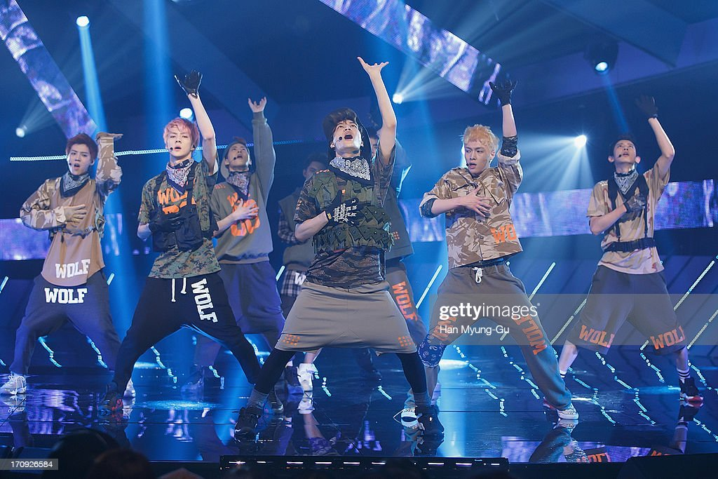 Members of boy band EXO perform onstage during the Mnet 'M CountDown' at CJ EM Center on June 20 2013 in Seoul South Korea