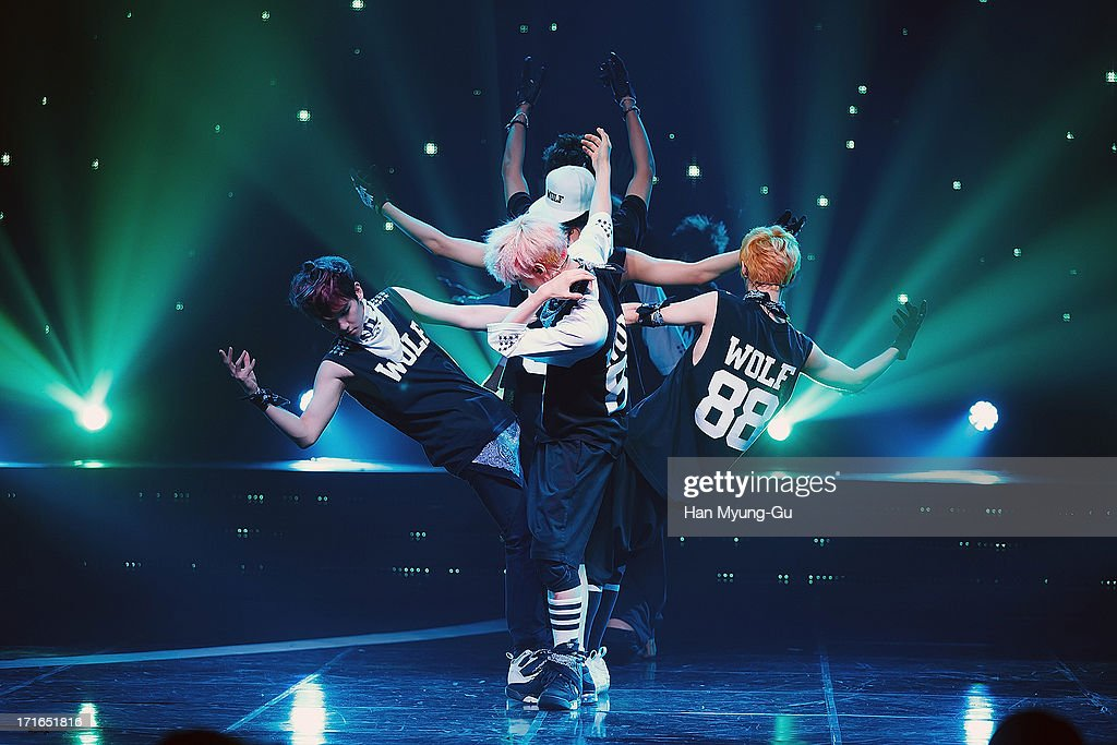 Members of boy band EXO perform onstage during the Mnet 'M CountDown' at CJ EM Center on June 27 2013 in Seoul South Korea