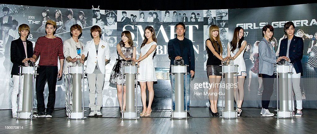 Members of boy band EXO-M, Onew and Taemin of South Korean boy band SHINee, Tae Yeon and Seo Hyun of South Korean girl group Girls' Generation, Kim Young-Min of SM Entertainment CEO, Victoria and Krystal of South Korean girl group f(x) and members of boy band EXO-K attend during the 'S.M.ART Exhibition' opening ceremony held at Coex on August 09, 2012 in Seoul, South Korea.