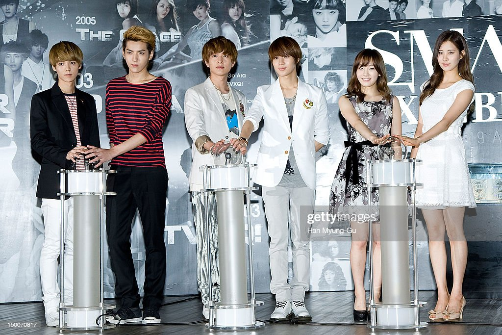 Members of boy band EXO-M, Onew and Taemin of South Korean boy band SHINee and Tae Yeon and Seo Hyun of South Korean girl group Girls' Generation attend during the 'S.M.ART Exhibition' opening ceremony held at Coex on August 09, 2012 in Seoul, South Korea.
