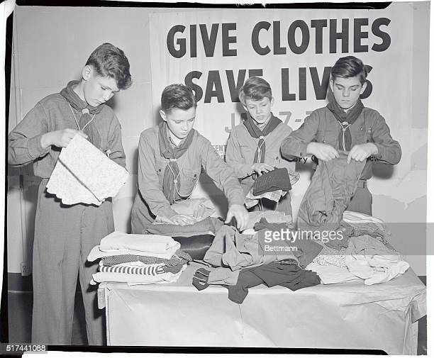 Members of Boy Scout Troop 560 Manhattan illustrate the proper way to pack clothing donated to the Victory Clothing Collection The clothing should be...