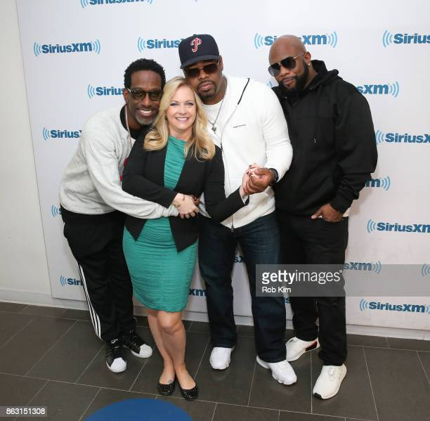 Members of Boyz II Men Shawn Stockman Nathan Morris and Wanya Morris pose for a group photo with actress Melissa Joan Hart at SiriusXM Studios on...