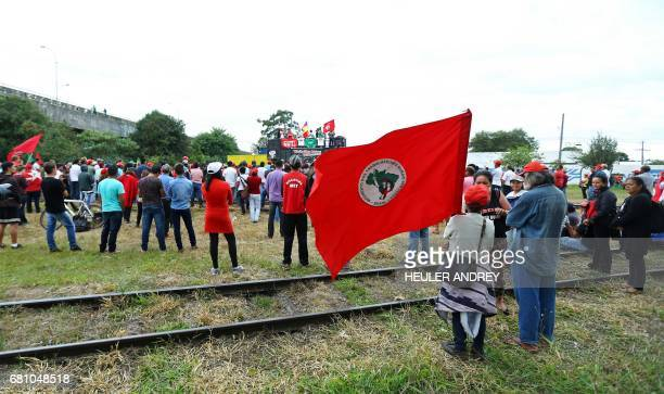 Members of Brazil's Landless Workers Movement gather at a camp in Curitiba Brazil on May 9 2017 Hundreds of supporters of former Brazilian president...