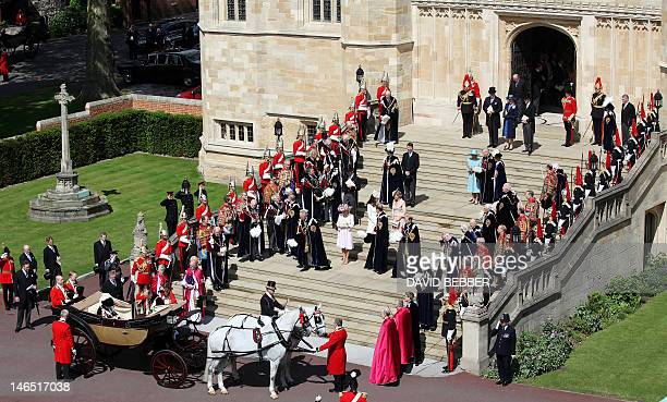 Members of Britain's royal family leave St George's Chapel following the service of the Order of the Garter at Windsor Castle in Berkshire on June 18...