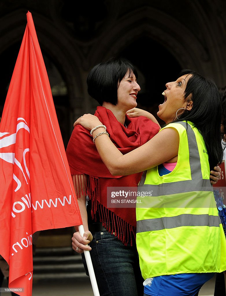 Members of British Airways cabin react outside the High Court in London on May 20, 2010. British Airways cabin crew could go on strike from Monday after their union won an appeal against a court injunction which had prevented a planned stoppage from going ahead. 'There will be no industrial action this week,' the Unite union's joint general secretary Derek Simpson said as he welcomed the High Court's judgment on Thursday.