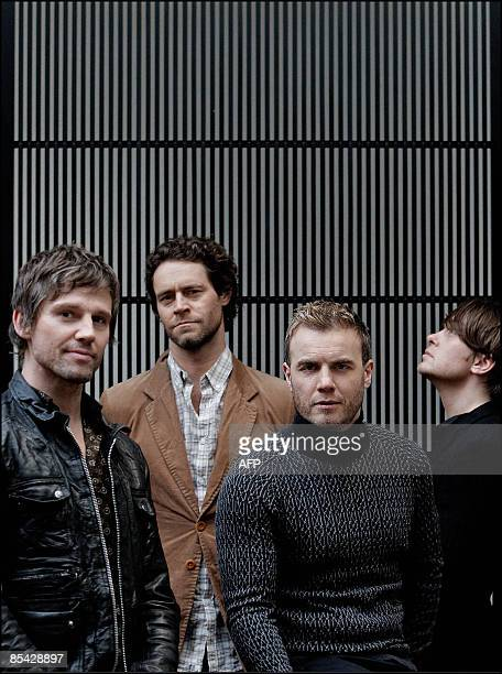 Members of British boys band Take That Jason Orange Howard Donald Gary Barlow and Mark Owen pose on March 14 2009 in an hotel of Amsterdam The band...