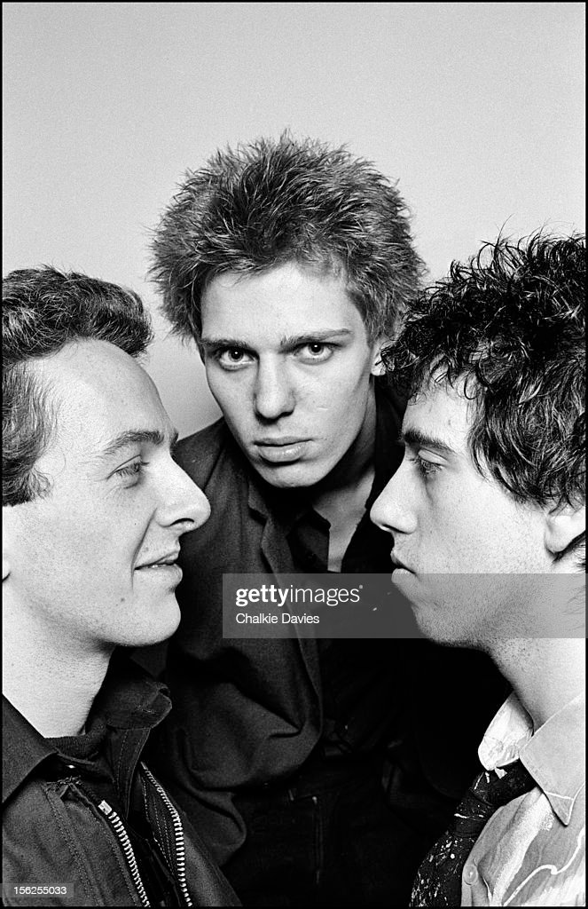 Members of British punk group The Clash, at their manager Bernie Rhodes's 'Rehearsal Rehearsals' studio in Camden Town, London, 1977. Left to right: singer <a gi-track='captionPersonalityLinkClicked' href=/galleries/search?phrase=Joe+Strummer&family=editorial&specificpeople=226957 ng-click='$event.stopPropagation()'>Joe Strummer</a> (1952 - 2002), bassist <a gi-track='captionPersonalityLinkClicked' href=/galleries/search?phrase=Paul+Simonon&family=editorial&specificpeople=216507 ng-click='$event.stopPropagation()'>Paul Simonon</a> and guitarist <a gi-track='captionPersonalityLinkClicked' href=/galleries/search?phrase=Mick+Jones+-+Musician+-+The+Clash&family=editorial&specificpeople=212985 ng-click='$event.stopPropagation()'>Mick Jones</a>.