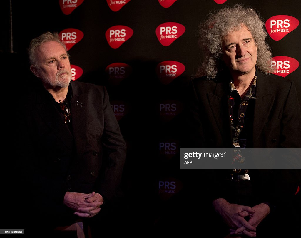 Members of British rock band Queen Brian May (R) and Roger Taylor (L) attend a ceremony in which Queen were awarded the PRS for Music Heritage Award at Imperial College London in London on March 5, 2013. A plaque was unveiled during the ceremony at the Imperial College London, where Queen played their first public gig in the Student Union on July 18,1970.