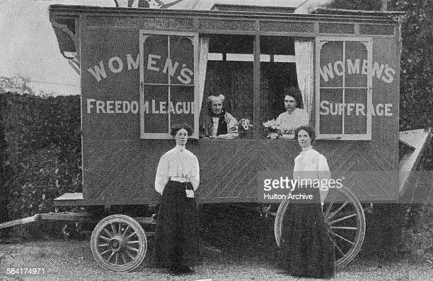 Members of British suffragist organization the Women's Freedom League with a touring publicity caravan 1908 WFL cofounder Charlotte Despard is second...