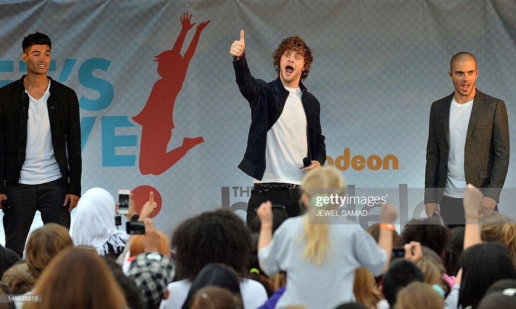 Members of British-Irish boy band The Wanted perform on stage during US First Lady's 'Let's Move-London' event at the Winfield House in London on July 27, 2012, hours before the start of the London 2012 Olympic Games. AFP PHOTO/Jewel Samad