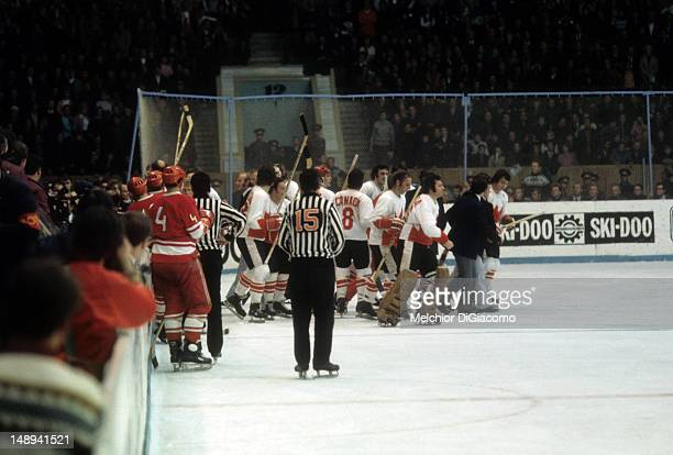 Members of Canada escort player agent Alan Eagleson after Eagleson went after the goal judge on a disputed call during Game 8 of the 1972 Summit...