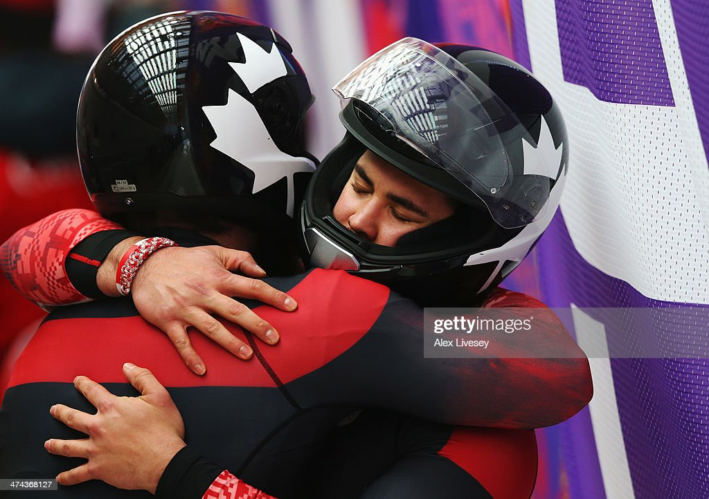 Members of Canada team 1 react after a run during the Men's Four-Man Bobsleigh on Day 16 of the Sochi 2014 Winter Olympics at Sliding Center Sanki on February 23, 2014 in Sochi, Russia.