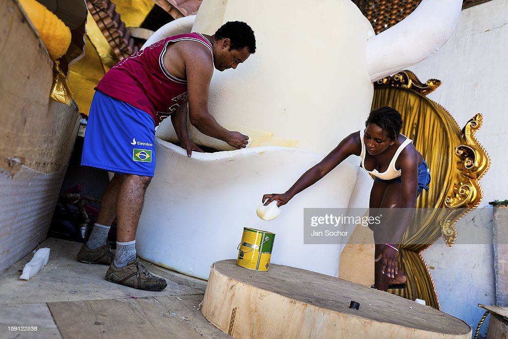 Members of Caprichosos de Pilares samba school work on a carnival float inside the workshop in Rio de Janeiro, Brazil, 14 February 2012. The carnival preparations start early in July or August, some 7-8 months before the main samba schools parade at the sambodrome. Samba schools hire teams of professional designers and artists who, according to the original theme selected by the school directors and then featured by the school during the parade, create allegorical floats, costumes, sculptures, music, choreography and the entire school show. However, the most of the everyday work in the carnival hangars is performed by unknown but fully dedicated samba schools members.
