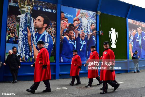 Members of Chelsea Pensioners make their way to the game before the Premier League match at Stamford Bridge London