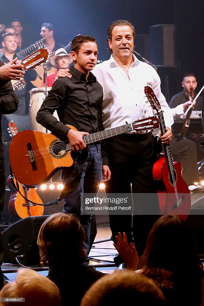 Members of 'Chico & The Gypsies' : Chico (founder of the group) and his grandson Tambo perform whyle their Concert with 50 gypsy guitars at L'Olympia on April 15, 2014 in Paris, France.