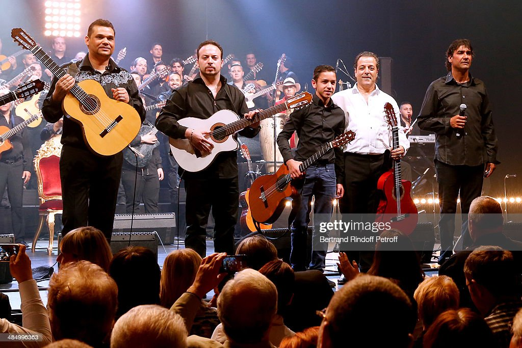 Members of 'Chico & The Gypsies' : Joseph, Kema (grandson of Manitas de Plata), Tambo (grandson of Chico), Chico (founder of the group) and Mounin perform whyle their Concert with 50 gypsy guitars at L'Olympia on April 15, 2014 in Paris, France.