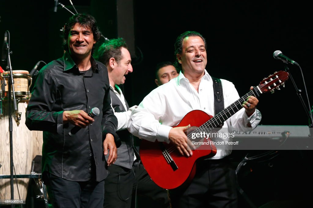 Members of 'Chico & The Gypsies' : Mounin and Chico (founder of the group) perform whyle their Concert with 50 gypsy guitars at L'Olympia on April 15, 2014 in Paris, France.