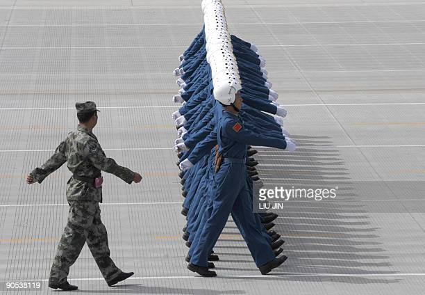 Members of China's Air Force battalion march as they rehearse for the National Day parade in Beijing on September 10 2009 China is planning a parade...