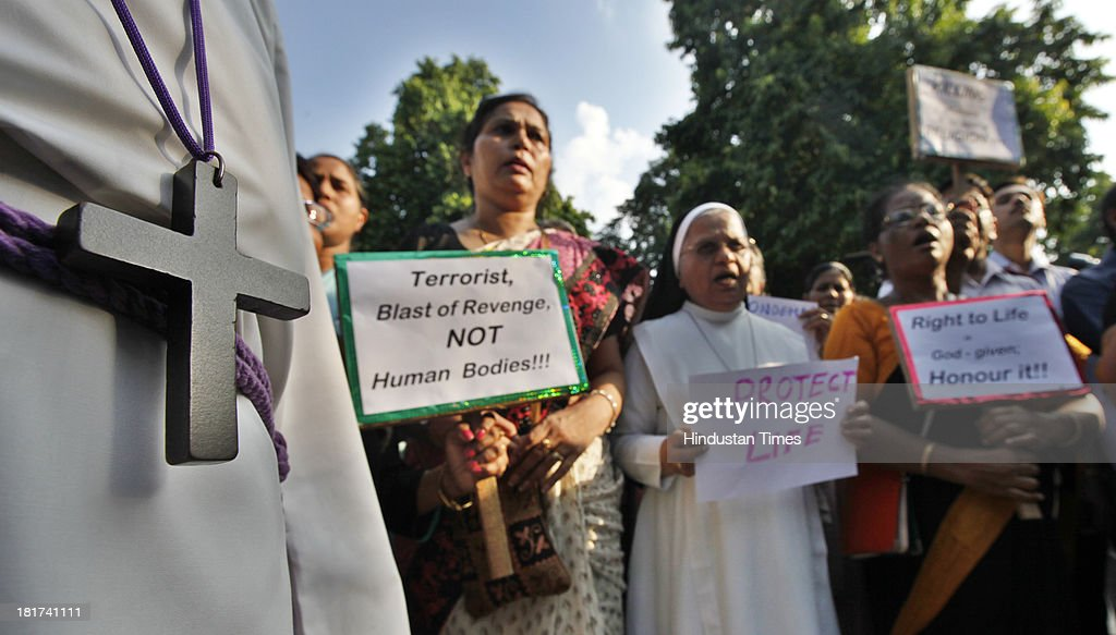 Members of Christian Community holding placards march to the Pakistan High Commission to express their anguish over Sunday's barbaric at All Saints Church in Peshawar on September 24, 2013 in New Delhi, India. At least 78 persons died and over 150 were injured in the suicide bomb attack inside an old Anglican Church in the Peshawar region of Pakistan.