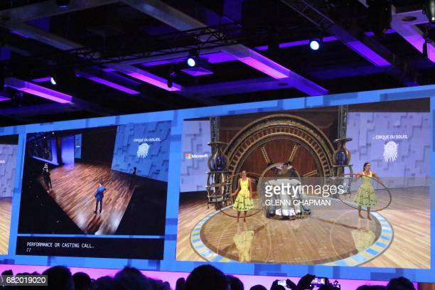Members of Cirque Du Soleil at Microsofts developers conference show how they plan to use HoloLens augmented reality gear to design new performances...