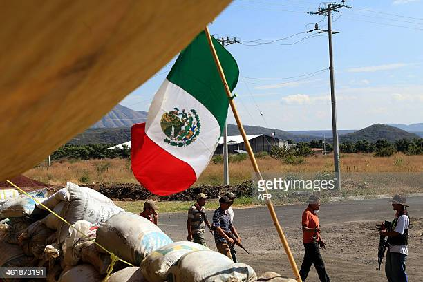 Members of citizens' SelfProtection Police patrol at the check point of Paracuaro community entrance on ApatzinganCuatro Caminos Road in Michoacan...