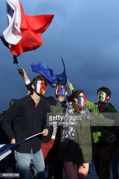 Members of civic organization Avaaz with their faces painted in the French German Italian and EU flags gather with other supporters of French...