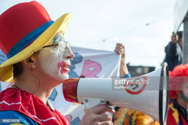 Members of Clowns against Nazism rally during a counter protest to the planned march of the Nordic Resistance Movement through central Gothenburg on...