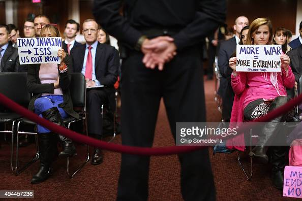 Members of Code Pink for Peace including Medea Benjamin silently protest as Defense Secretary Ashton Carter and Joint Chiefs of Staff Chairman Gen...