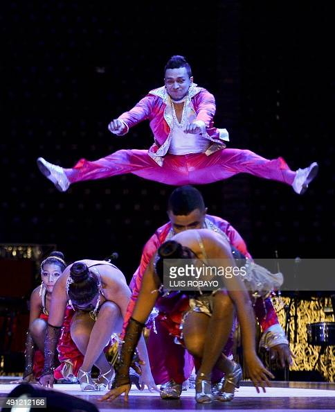 Members of Colombia's Sensacion Rumbera dance group participate in the cabaret groups category during the X World Salsa Festival at the Cañaveralejo...