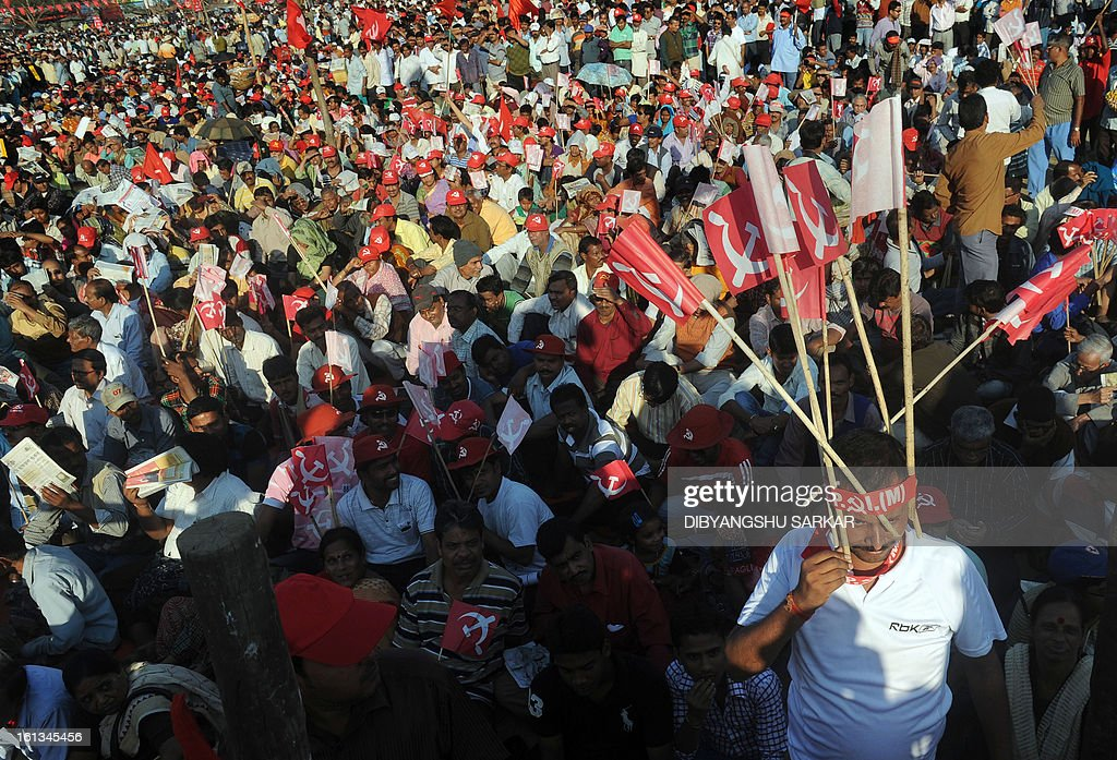Members of Communist Party of India (Marxist) CPI(M) attend a mass meeting at the Shahid Minar in Kolkata on February 10, 2013. Thousands of party supporters attended the meeting to listen to their leaders, to demand food and social security and protest against the recent price hike in daily necessary commodities. AFP PHOTO/Dibyangshu SARKAR