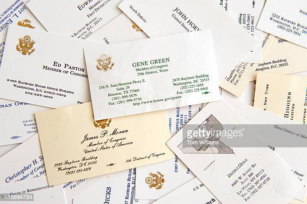 Members of Congress business cards are photographed to show there various designs