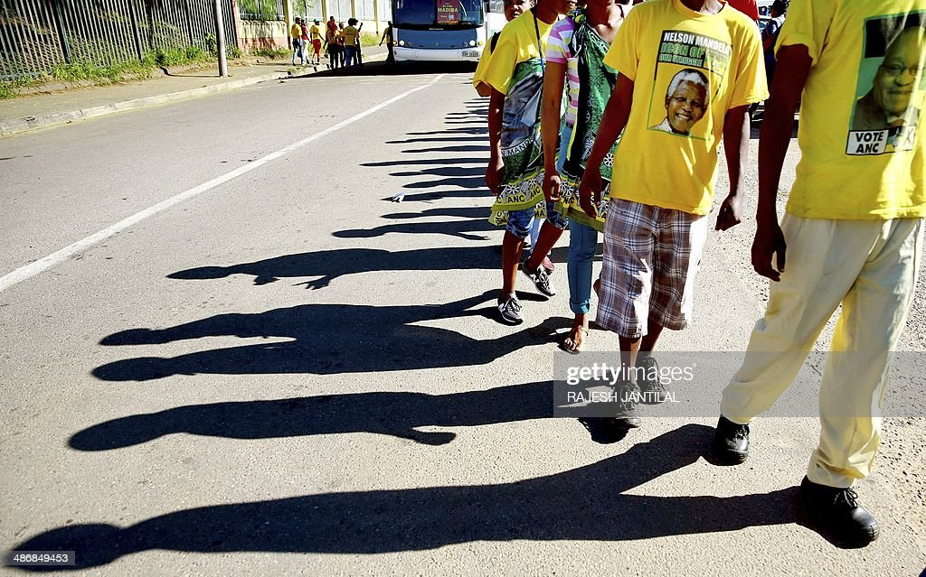 Members of Congress of South African Trade Unions (COSATU) and the South African Communist Party ( SACP) queue to enter the Curries Fountain grounds to participate in a march to support the ruling African National Congress ( ANC) in Durban on April 26, 2014. COSATU (South Africa's largest trade union comprising of over 2 million workers) and the SACP are in a tripartite alliance with the ANC, and have declared their support to the ANC in the upcoming elections on May 7, 2014.
