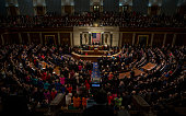 STATES JANUARY 12 Members of Congress stand up to applaud as President Barack Obama speaks on the strength of the military during his final State of...