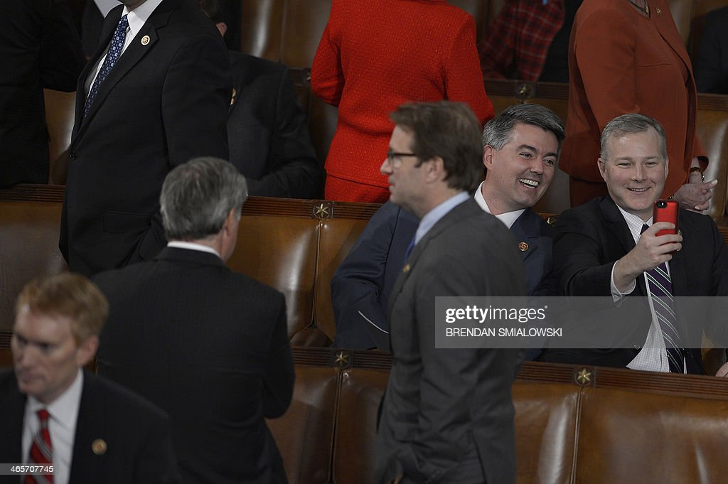 Members of Congress take self photos with a smart phone before US President Barack Obama delivers the State of the Union address before a joint session of Congress on January 28, 2014 at the US Capitol in Washington. AFP PHOTO/Brendan SMIALOWSKI
