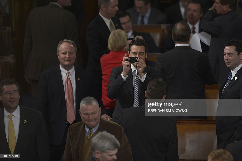 A members of Congress takes photos with a smart phone before US President Barack Obama delivers the State of the Union address before a joint session of Congress on January 28, 2014 at the US Capitol in Washington. AFP PHOTO/Brendan SMIALOWSKI