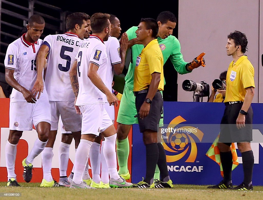 Members of Costa Rica argue a penalty against Roy Miller #19 of Costa Rica in the final minute of overtime against Mexico during the quarterfinals of the 2015 CONCACAF Gold Cup at MetLife Stadium on July 19, 2015 in East Rutherford, New Jersey.The penalty kick by Mexico resulted in a score to win the game against Costa Rica.