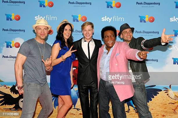 Members of Culcha Candela Itchy and Reedoo actor David Kross actress Johanna Klum and singer Roberto Blanco attend the German Premiere of 'RIO' at...