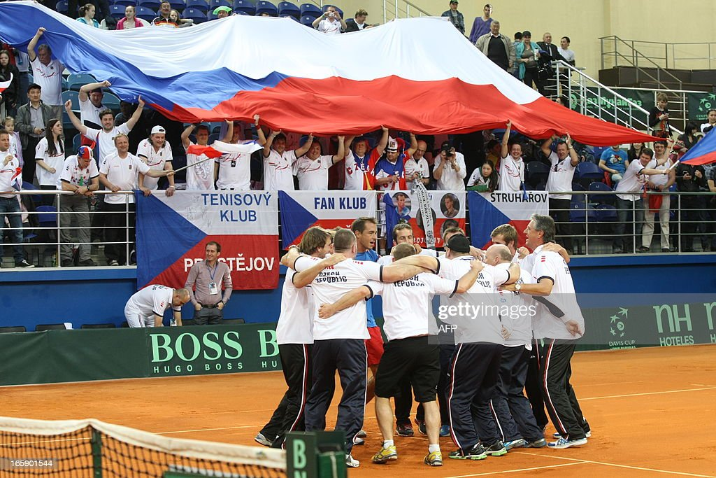 Members of Czech Republic's tennis team celebrate their victory after their Davis Cup quarterfinal tennis match against Kazakhstan in the Kazakh capital Astana, on April 7, 2013.
