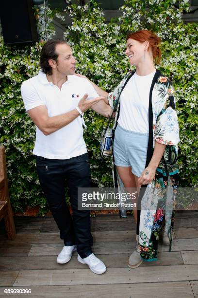 Members of 'Dance avec les Stars' Philippe Candeloro and Fauve Hautot attend the 2017 French Tennis Open Day Two at Roland Garros on May 29 2017 in...