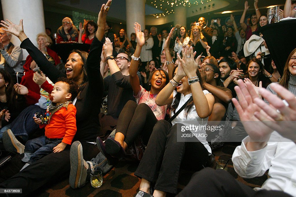Members of Democrats Abroad celebrate as they watch a live broadcast of the inauguration ceremony of US President Barack Obama on January 20, 2009 in Barcelona. Obama took the oath of office to become the first black president in US history, proclaiming America had chosen 'hope over fear' and must unite in a 'new era of responsibility' to triumph over its multiple crises.