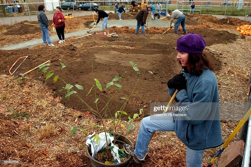 SHARE    Members Of Denver Urban Gardens And Parents Of Students From  Academia Of Ana