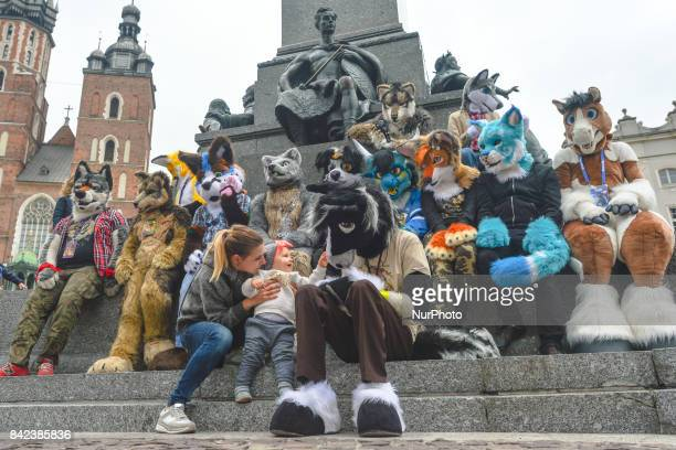 Members of different Furry Fandom Conventions pose for a photo at Adam Mickiewicz's monument in Krakow Main Market Square On Friday September 1 in...
